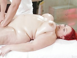 Redhead BBW April Flores gets a nice boobs massage with an increment of gets fucked