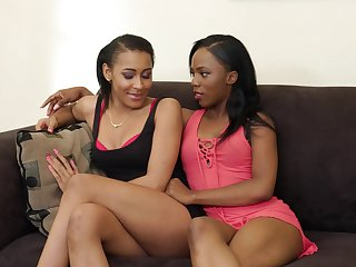 Negro lesbian couple is going-over new sex toy