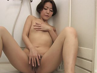 Asian woman loves a bit of private time with her snatch