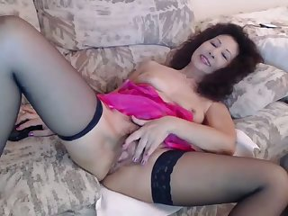 This slut fucks himself with her toy with passion and can tell she is loving it