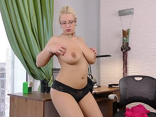 Amateur cougar Luba Love opens her hands to sketch in the office